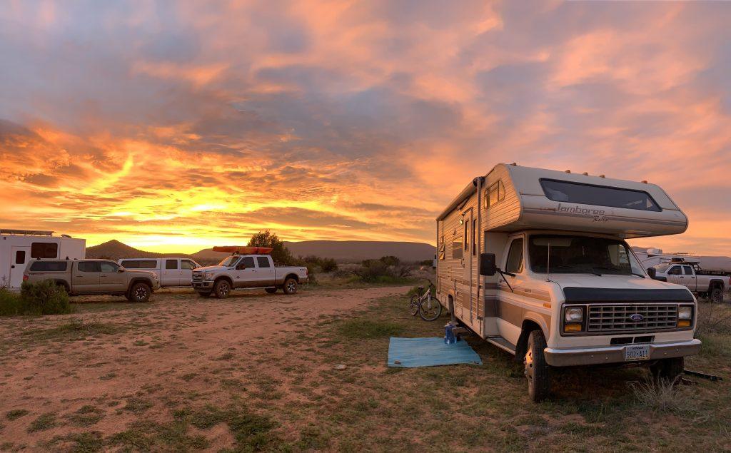 RV in desert at sunset