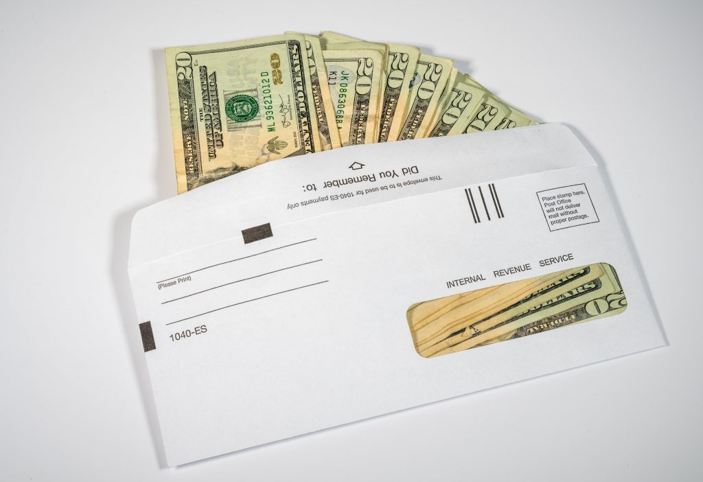 envelope of cash representing paycheck protection program
