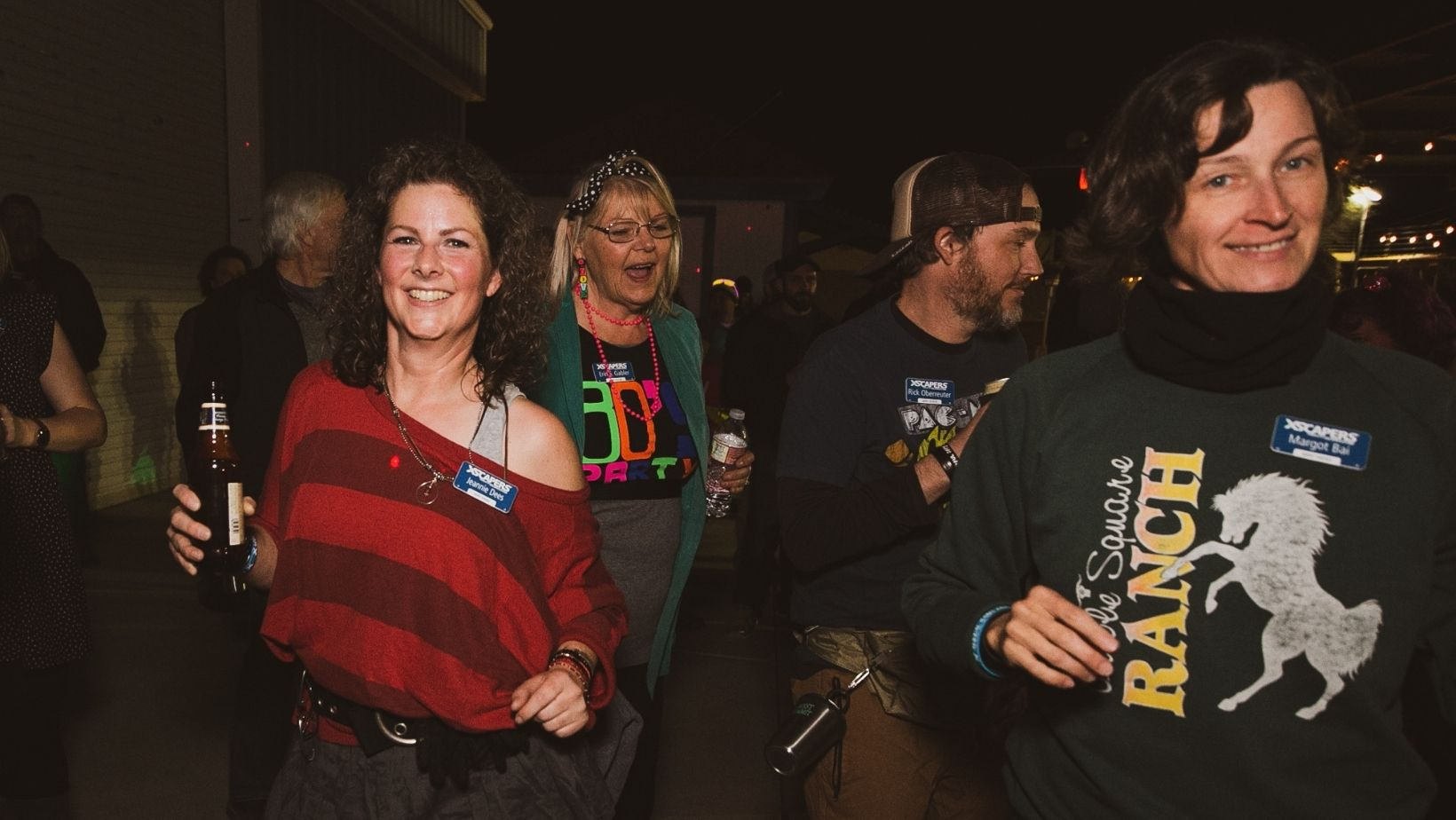 Attendees show off their 80s apparel during 80s night at an Xscapers Convergence