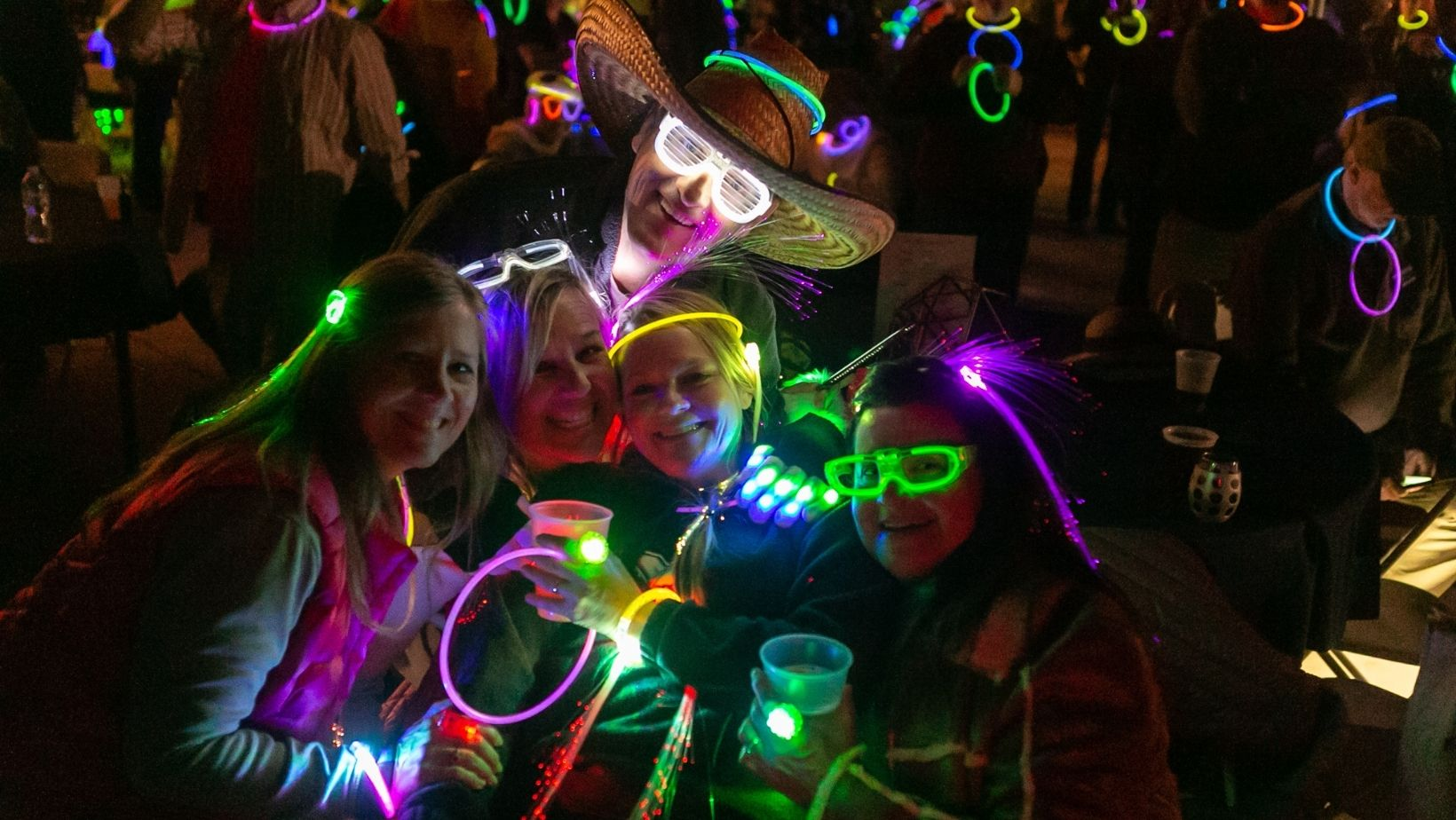 Attendees gather for a photo during Neon Night at an Xscapers Convergence