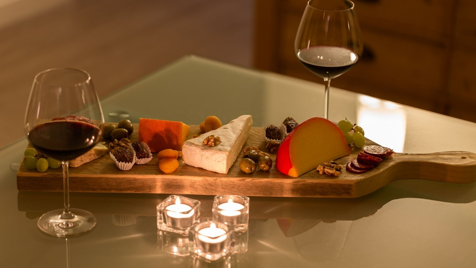 A tray of cheese with a glass of wine is a great way to have a simple date night with your co-parent.